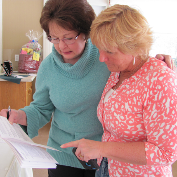 Volunteers compare notes for fund raiser