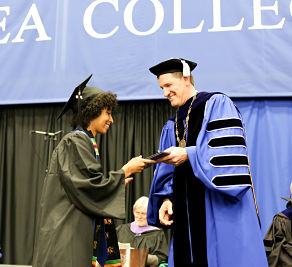 Equipping youth - young woman receiving college diploma